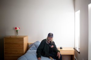 """Joe Meyer, 62, sits in his new apartment at Huston Commons, Portland's third """"housing first"""" program for chronically homeless people. """"""""This is a life-changing type of thing,"""" he said."""